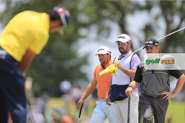 Hideki Matsuyama (JAP) watched by playing partners Graeme McDowell (NIR) and Louis Oosthuizen (RSA) during round 2 of the Players, TPC Sawgrass, Championship Way, Ponte Vedra Beach, FL 32082, USA. 13/05/2016.<br /> Picture: Golffile | Fran Caffrey<br /> <br /> <br /> All photo usage must carry mandatory copyright credit (&copy; Golffile | Fran Caffrey)