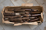 28/09/2014. Al-Yarubiyah, Syria. 12.7mm (.50 caliber) rounds, lie on the floor of a building in Al-Yarubiyah, Syria, as they wait to be used by Syrian-Kurdish YPG snipers firing at positions held by Islamic State insurgents in Rabia, Iraq.<br /> <br /> Facing each other across the Iraq-Syria border, the towns of Al-Yarubiyah, Syria, and Rabia, Iraq, were taken by Islamic State insurgents in August 2014. Since then The town of Al-Yarubiyah and parts of Rabia have been re-taken by fighters from the Syrian Kurdish YPG. At present the situation in the towns is static, but with large exchanges of sniper and heavy machine gun fire as well as mortars and rocket propelled grenades, recently occasional close quarter fighting has taken place as either side tests the defences of the other.