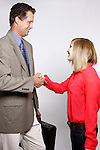 A businessman and businesswoman handshaking
