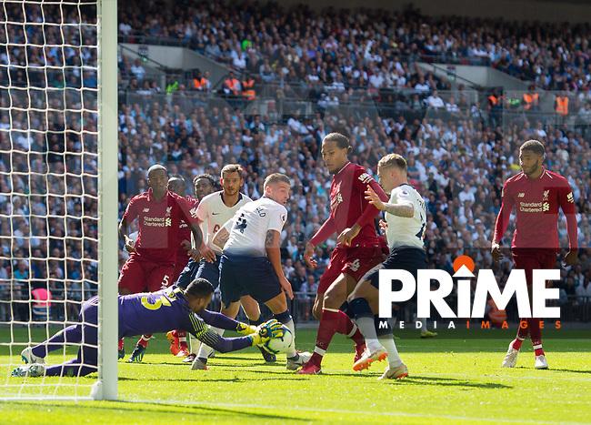 Liverpool's Virgil van Dijk and Tottenham's Michel Vorm during the Premier League match between Tottenham Hotspur and Liverpool at Wembley Stadium, London, England on 15 September 2018. Photo by Andrew Aleksiejczuk / PRiME Media Images.