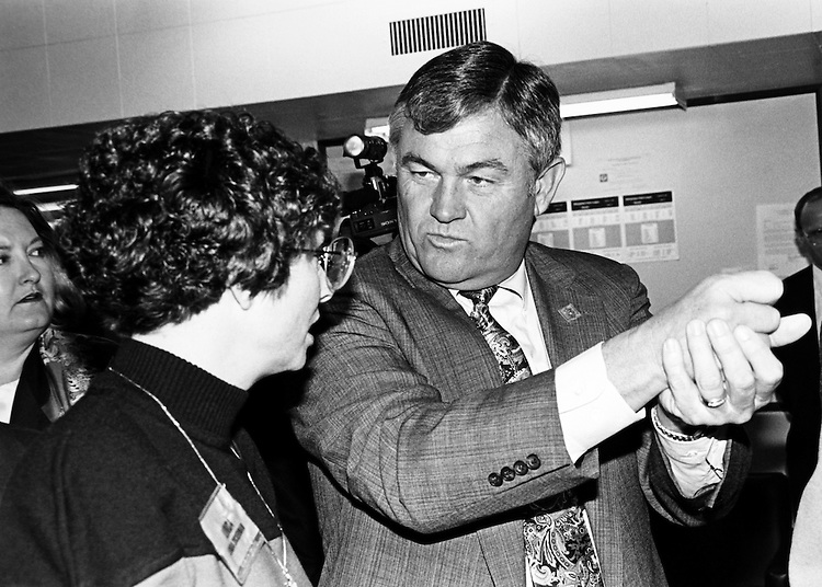 Rep. William K. Brewster, D-Okla. giving Linda Luckerman (wife of Rep. Mike Koretski) a few pointers after the first relay of firing at the NRA sponsored event, which Suzy Brewster hosted at the NRA Rifle Range. November 5, 1991. (Photo by Maureen Keating/CQ Roll Call)