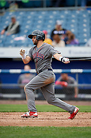 Lehigh Valley IronPigs third baseman Trevor Plouffe (19) follows through on a swing during a game against the Syracuse Chiefs on May 20, 2018 at NBT Bank Stadium in Syracuse, New York.  Lehigh Valley defeated Syracuse 5-2.  (Mike Janes/Four Seam Images)