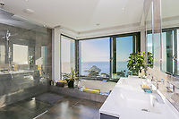BNPS.co.uk (01202 558833)<br /> Pic: KnightFrank/BNPS<br /> <br /> Stunning view from the house to Thatcher's Rock<br /> <br /> A luxury seaside home that has gone on the market for £3m is a turn off for any Labour voter - as it looks out on to Thatcher's Rock.<br /> <br /> The modern and contemporary property is in one of the most exclusive areas of Torquay in Devon and has spectacular views of Tor Bay.<br /> <br /> In the foreground in the rocky outcrop known as Thatcher's Rock.<br /> <br /> But the coastal landmark isn't named after the late Tory Prime Minister but the fact that from certain angles the rock formation looks like a thatcher working on a roof.