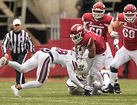 Hawgs Illustrated/BEN GOFF <br /> David Williams, Arkansas running back, takes a hit from Johnathan Abram, Mississippi State safety, in the fourth quarter Saturday, Nov. 18, 2017, at Reynolds Razorback Stadium in Fayetteville.