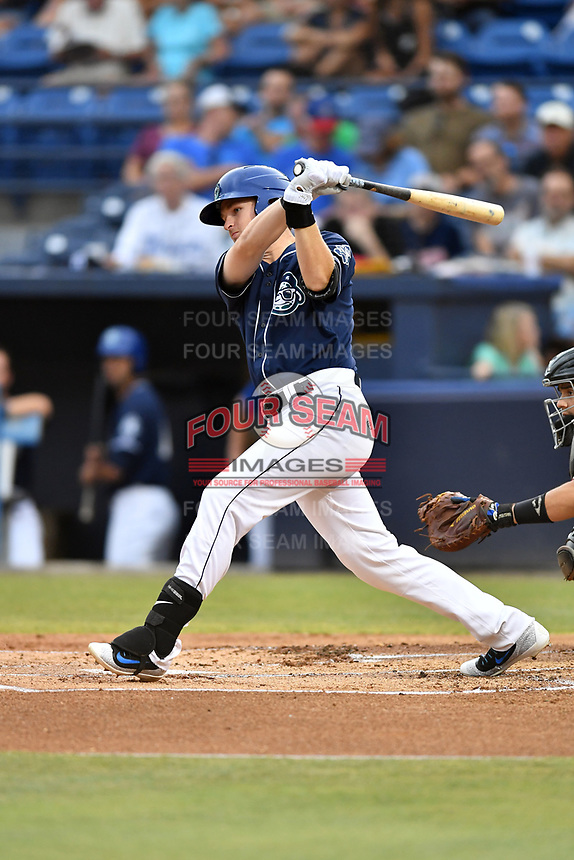Asheville Tourists designated hitter Tyler Nevin (23) swings at a pitch during a game against the Hickory Crawdads at McCormick Field on July 13, 2017 in Asheville, North Carolina. The Tourists defeated the Crawdads 9-4. (Tony Farlow/Four Seam Images)