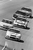 #41 Chevrolet driven by  driven by Greg Sacks leads a pack of cars during the DieHard 500, NASCAR Winston Cup race, Talladega Superspeedway, July 26, 1992.  (Photo by Brian Cleary/bcpix.com)