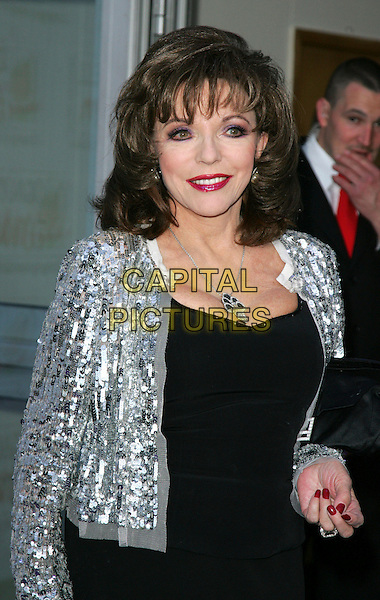 "JOAN COLLINS .Caudwell Childrens Charity's ""Legends Ball"" held at the Battersea Evolution,, London - .May 8th 2008.half length silver jacket black dress red lipstick nail varnish polish sequins sequined necklace .CAP/ROS.©Steve Ross/Capital Pictures."