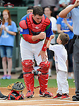 Catcher Jordan Procyshen (17) of the Greenville Drive fist bumps with a fan before a game against the Augusta GreenJackets on Sunday, April 12, 2015, at Fluor Field at the West End in Greenville, South Carolina. Augusta won, 2-1. (Tom Priddy/Four Seam Images)