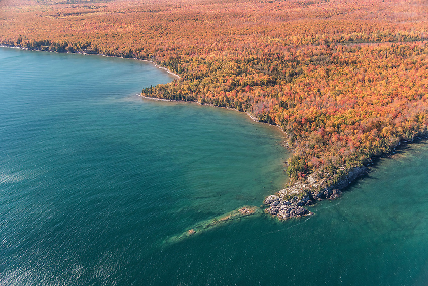 Aerial photography of the Lake Superior shoreline between Marquette and Big Bay, Michigan during fall color season.