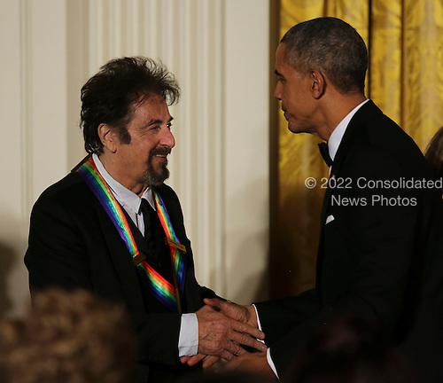 United States President Barack Obama shakes hands with actor Al Pacino, one of the Kennedy Center Honorees in the East Room of the White House, December 4, 2016, Washington, DC.  The 2016 honorees are: Argentine pianist Martha Argerich; rock band the Eagles; screen and stage actor Al Pacino; gospel and blues singer Mavis Staples; and musician James Taylor.<br /> Credit: Aude Guerrucci / Pool via CNP