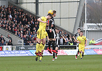 Cammy Smith and Craig Halkett challenge in the air in the St Mirren v Livingston Scottish Professional Football League Ladbrokes Championship match played at the Paisley 2021 Stadium, Paisley on 14.4.18.