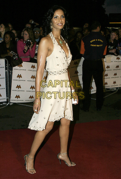 PADMA LAKSHMI - LAKESHMI.MOBO Awards 2004 - Arrivals, Royal Albert Hall.September 30th, 2004.full length, studded white dress, halterneck, cleavage, plunging neckline, scar.www.capitalpictures.com.sales@capitalpictures.com.© Capital Pictures.