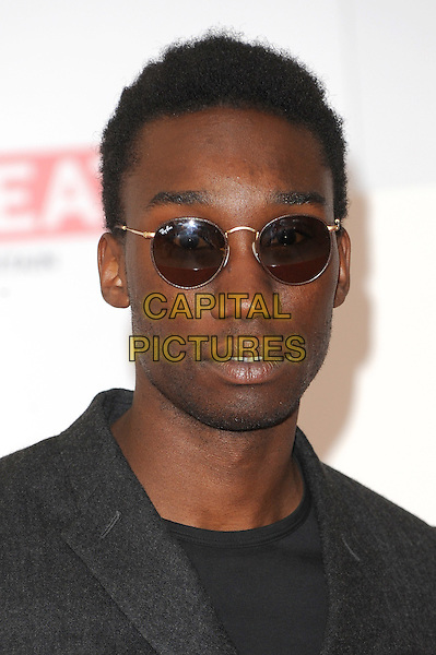 Nathan Stewart-Jarrett .The UK Creative Industries Reception supported by The Founders Forum, at the Royal Academy of Arts, London, as part of HM Government's GREAT campaign alongside the very best of the UK Creative Industries from the fields of music, film, art and entertainment..30th July 2012 .headshot portrait black sunglasses shades.CAP/BEL.©Tom Belcher/Capital Pictures.