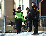 East Hartford Police search in the neighborhood behind  the American Eagle Credit Union on Main Street in East Hartford after an armed robbery, Thursday, Jan. 3, 2007 (Jim Michaud/Jouranl Inquirer)
