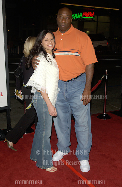 Actor MICHAEL CLARKE DUNCAN & girlfriend at the world premiere, in Hollywood, of Walking Tall..March 29, 2004
