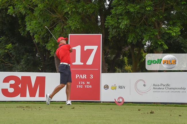 Zheng Kai BAI (CHN) watches his tee shot on 17 during Rd 3 of the Asia-Pacific Amateur Championship, Sentosa Golf Club, Singapore. 10/6/2018.<br /> Picture: Golffile | Ken Murray<br /> <br /> <br /> All photo usage must carry mandatory copyright credit (© Golffile | Ken Murray)