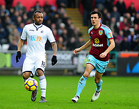 Swansea City's Jordan Ayew vies for possession with Burnley's Jack Cork<br /> <br /> Photographer Ashley Crowden/CameraSport<br /> <br /> The Premier League - Swansea City v Burnley - Saturday 10th February 2018 - Liberty Stadium - Swansea<br /> <br /> World Copyright &copy; 2018 CameraSport. All rights reserved. 43 Linden Ave. Countesthorpe. Leicester. England. LE8 5PG - Tel: +44 (0) 116 277 4147 - admin@camerasport.com - www.camerasport.com