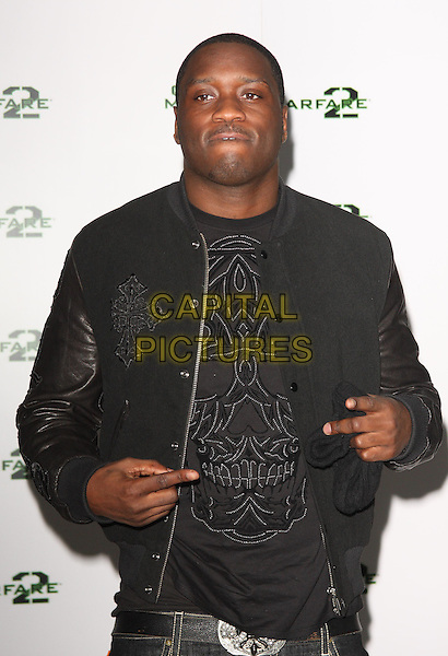 "LETHAL BIZZLE .""Call Of Duty - Modern Warfare 2"" Video Game Launch at the Vue Cinema, Leicester Square, London, England, November 9th 2009..half length back skull jacket t-shirt hand fingers gesture .CAP/ROS.©Steve Ross/Capital Pictures."