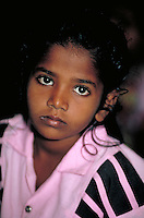 portrait of a young Sri Lankan girl, child, children. Young girl, portrait. Colombo, Sri Lanka inside church.