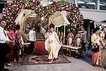 PHNOM PHEN, CAMBODIA, APRIL 2013:<br />Il matrimonio di Learg Sen e Ok Rotha nella sala D del Mondial Centre, realizzato nel 2002 su un terreno in Mao Tse-Tung Boulevard dove  si trovava il mercato dei ladri. Ha una capacit&agrave; di 5000 persone sedute a 500 tavoli in 17 sale. Un tavolo per 10 costa da 20 a 22 dollari. Per la cena bisogna aggiungere circa 100 dollari a tavolo.&copy; Giulio Di Sturco per &quot;D&quot; della Repubblica