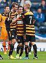 Alloa's Kevin Cawley (centre) celebrates after he scores their first goal.
