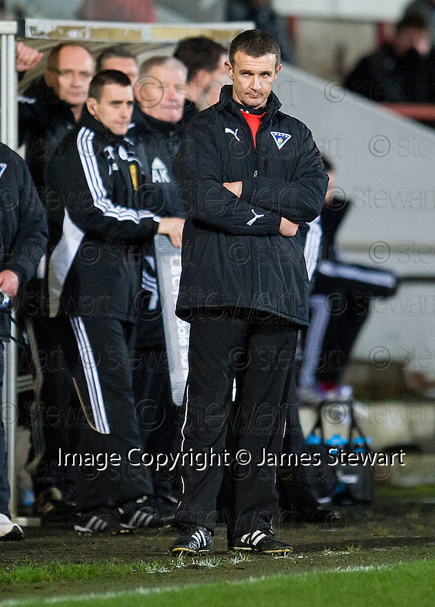 DUNFERMLINE MANAGER JIM MCINTYRE AFTER HE SEES HIS SIDE THROW AWAY A TWO GOAL LEAD