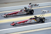 Apr. 14, 2012; Concord, NC, USA: NHRA top alcohol dragster driver Matthew Cummings (near lane) races alongside Dan Page during qualifying for the Four Wide Nationals at zMax Dragway. Mandatory Credit: Mark J. Rebilas-