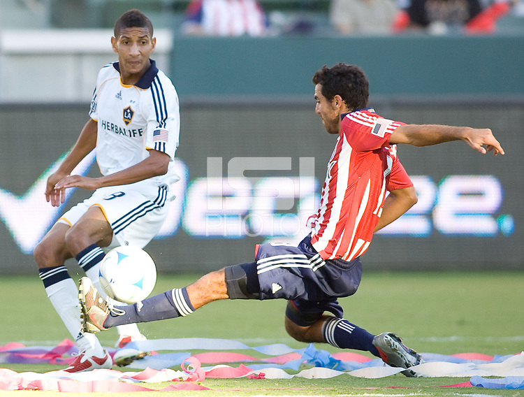 Chivas USA defender Jonathan Bornstein plays a ball past LA Galaxy defender Sean Franklin. The LA Galaxy and Chivas USA played to 2-2 draw during a MLS Western Conference playoff game at Home Depot Center stadium in Carson, California on Sunday November 1, 2009...