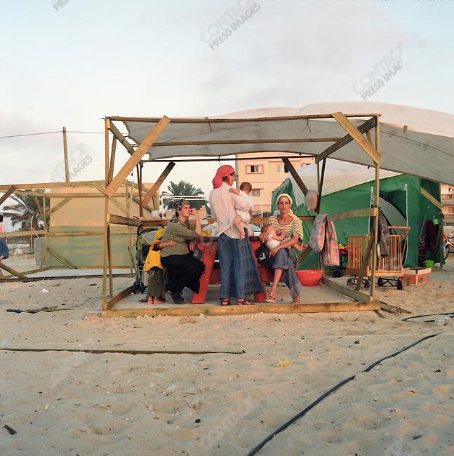 Jewish settlers erect temporary housing on a beach in Shirat Hayam settlement, Gaza, July 2005.