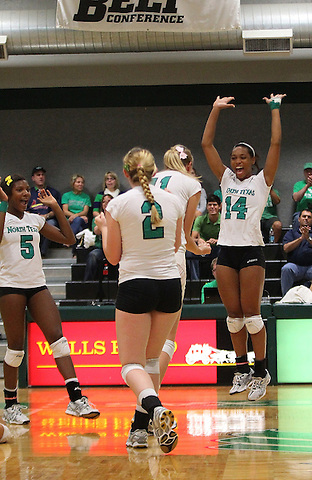 Denton, TX - OCTOBER 19: Eboni Godfrey #14 of the University of North Texas Mean Green Volleyball celebrates  with Courtney Windham #11 and May Allen #2 for a point against the Florida International University at University of North Texas Volleyball Complex in Denton on October 19, 2012 in Denton, Texas. (Photo by Rick Yeatts)