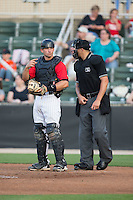 Kannapolis Intimidators catcher Ryan Plourde (28) and home plate umpire Justin Robbins wait for the next Delmarva Shorebirds batter to step up to the plate at CMC-Northeast Stadium on June 6, 2015 in Kannapolis, North Carolina.  The Shorebirds defeated the Intimidators 7-2.  (Brian Westerholt/Four Seam Images)