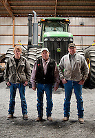 From left, Clark Frische (cq), Terry Frische (cq), and Myles Frische (cq) in front of their tractor at their cotton farm in Dumas, Texas, Tuesday, February 15, 2011. With the high price of cotton in recent years, many farmers in the area have switched to start farming cotton...Photo by Matt Nager