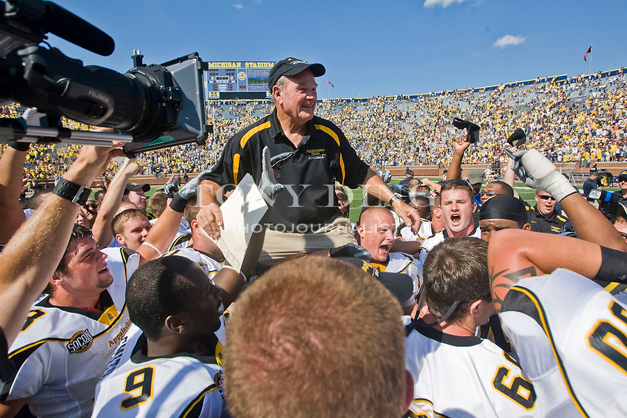1 September 2007: Appalachian State head coach Jerry Moore, center, is lifted up by his players as they celebrate after upsetting Michigan 34-32 in the 2007 college football season opener game at Michigan Stadium in Ann Arbor, MI.