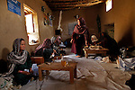 Members of a women Co-op knit dresses at a Mosque in the Yakawlang  District of Bamyan province. ..Afghanistan - 2011