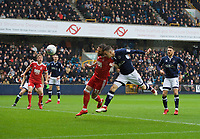 Shaun Williams of Millwall scores the opening goal during the Sky Bet Championship match between Millwall and Nottingham Forest at The Den, London, England on 30 March 2018. Photo by Alan  Stanford / PRiME Media Images.
