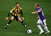 Phoenix captain Andrew Durante confronts Adriano Pellegrino during the A-League football match between Wellington Phoenix and Perth Glory at Westpac Stadium, Wellington, New Zealand on Sunday, 16 August 2009. Photo: Dave Lintott / lintottphoto.co.nz