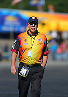 Aug 21, 2016; Brainerd, MN, USA; Bob Wilber , crew member for NHRA funny car driver Tim Wilkerson during the Lucas Oil Nationals at Brainerd International Raceway. Mandatory Credit: Mark J. Rebilas-USA TODAY Sports