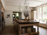 The stone-flagged kitchen has large windows overlooking the garden
