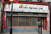 Closed estate agents premises in Shoreditch, London, a run-down commercial district  also known as Silicon Roundabout, which is undergoing gentrification as it becomes a centre for web-based companies and IT start-ups.