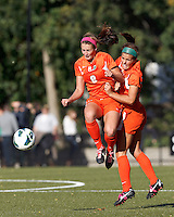 University of Miami defender Shannon McCarthy (8) heads the ball. University of Miami midfielder Kim Hutchinson (17)..After two overtime periods, Boston College (gold) tied University of Miami (orange), 0-0, at Newton Campus Field, October 21, 2012.