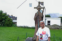 Sammi in front of St. Aidan Statue, Holy Island village