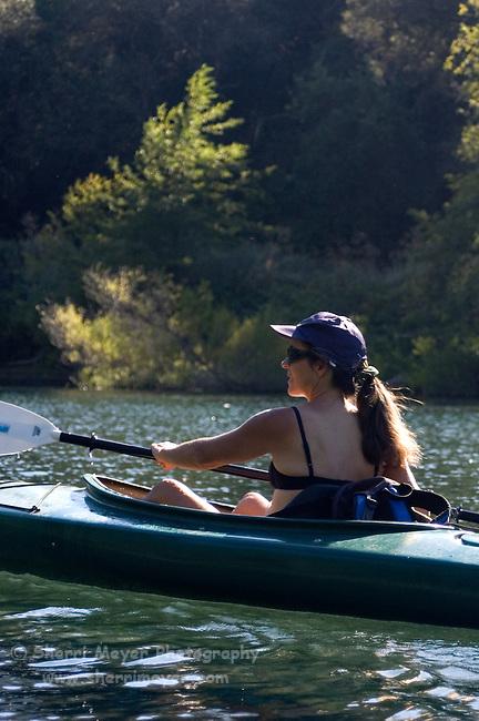 Woman kayaking Lake Clementine