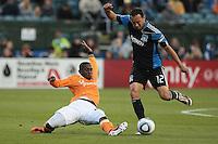 Houston Dynamo midfielder Lovel Palmer (22) slides tackles San Jose Earthquakes midfielder Ramiro Corrales (12). The San Jose Earthquakes defeated the Houston Dynamo 2-0 at Buck Shaw Stadium in Santa Clara, California on June 4th, 2011.