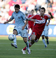Colorado Rapids defender Kosuke Kimura (27) clears the ball in front Chicago Fire midfielder Marco Pappa (16).  The Chicago Fire defeated the Colorado Rapids 3-2 at Toyota Park in Bridgeview, IL on August 23, 2009.