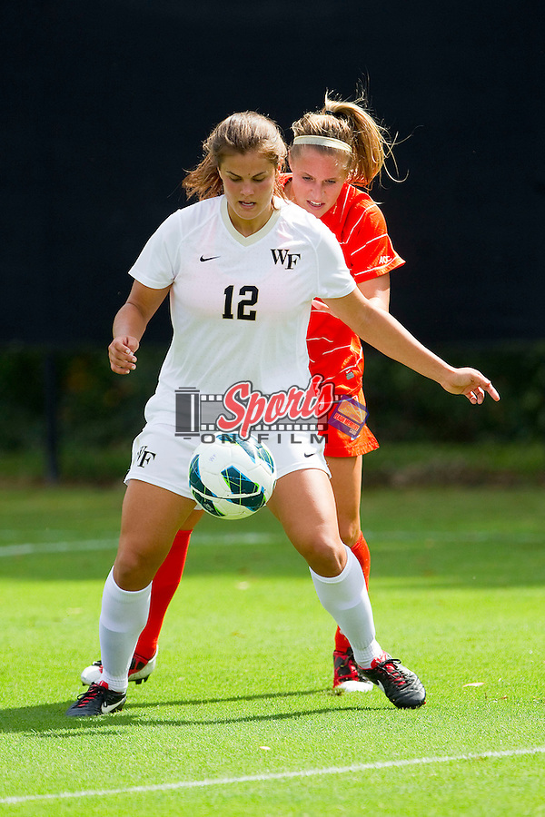 Katie Stengel (12) of the Wake Forest Demon Deacons controls the ball in front of Heather Marik (18) of the Clemson Tigers at Spry Soccer Stadium on September 30, 2012 in Winston-Salem, North Carolina.  The Demon Deacons defeated the Tigers 4-0.  (Brian Westerholt/Sports On Film)