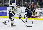 SIOUX FALLS, SD - OCTOBER 17:  Dillon Eichstadt #10 from the Sioux Falls Stampede puts a shot on goal in front of Michael Merulla #16 from the Madison Capitols in the first period Friday night at the Denny Sanford Premiere Center. (Photo/Dave Eggen/Inertia)