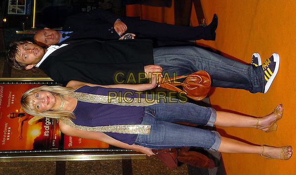 "LISA FAULKNER.""It's All Gone Pete Tong"" UK Premiere.May 26th, 2005.full length jeans denim purple sequins scarf holding hands cropped turned up rolled up brown leather bag purse.www.capitalpictures.com.sales@capitalpictures.com.©Capital Pictures"