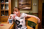 Emma Ouverson, age 9, drinks a rootbeer float on Sunday, December 4, 2011 in Webster City, IA.