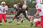 Palos Verdes, CA 09/30/11 - Okuoma Idah (Peninsula #24) in action during the Lawndale-Peninsula Varsity football game.
