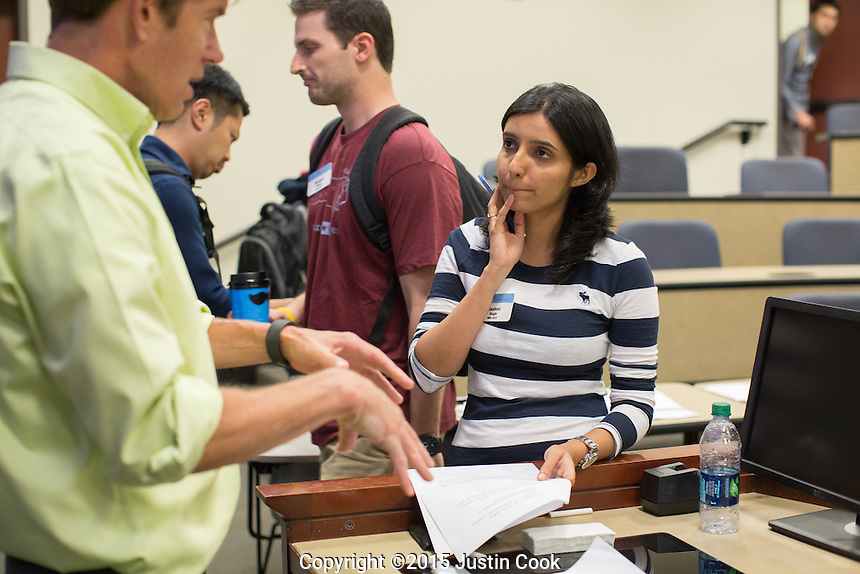 Rashmi Singh (CQ) talks with Professor Mark Lang after his class at the McColl Building at the Kenan-Flagler Business School at The University of North Carolina at Chapel Hill in Chapel Hill, NC on Friday, July 24, 2015. (Justin Cook for The Wall Street Journal)<br /> <br /> Story Summary: Students are showing up early on business-school campuses, even when they don&rsquo;t have to. At schools like UNC Chapel-Hill&rsquo;s Kenan-Flagler Business School and NYU Stern, summer sessions&mdash;intended to get students without business backgrounds up to speed before the semester begins&mdash;are growing in popularity as even finance whizzes say they don&rsquo;t want to miss the chance to polish their job-search plans and socialize with their new classmates.